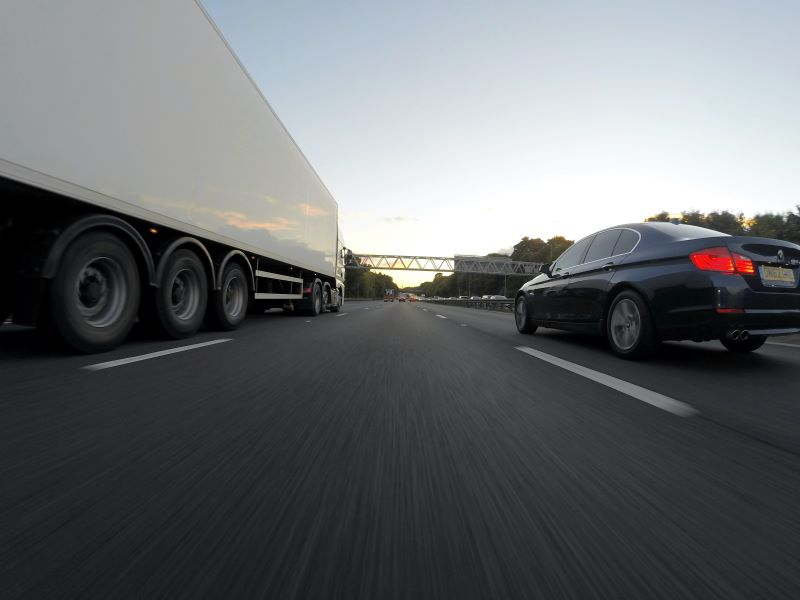 heavy-duty-truck-sharing-road-with-bmw.jpg