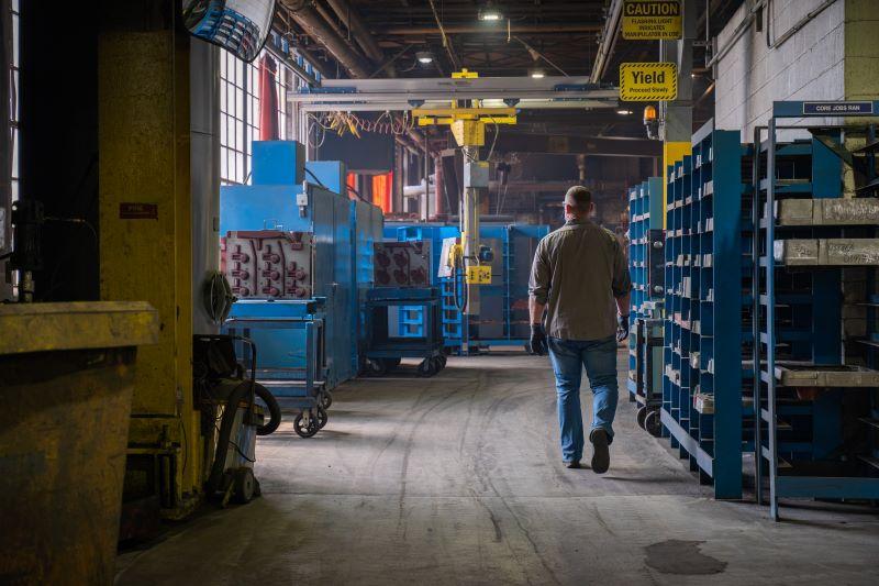 employee walking through ductile iron shop